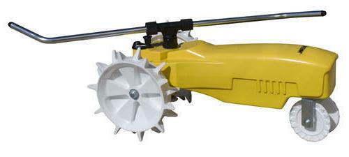 yellow traveling lawn sprinkler large area tractor